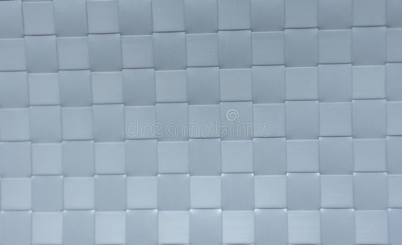 Branco plástico listrado do weave Usado como o fundo imagem de stock