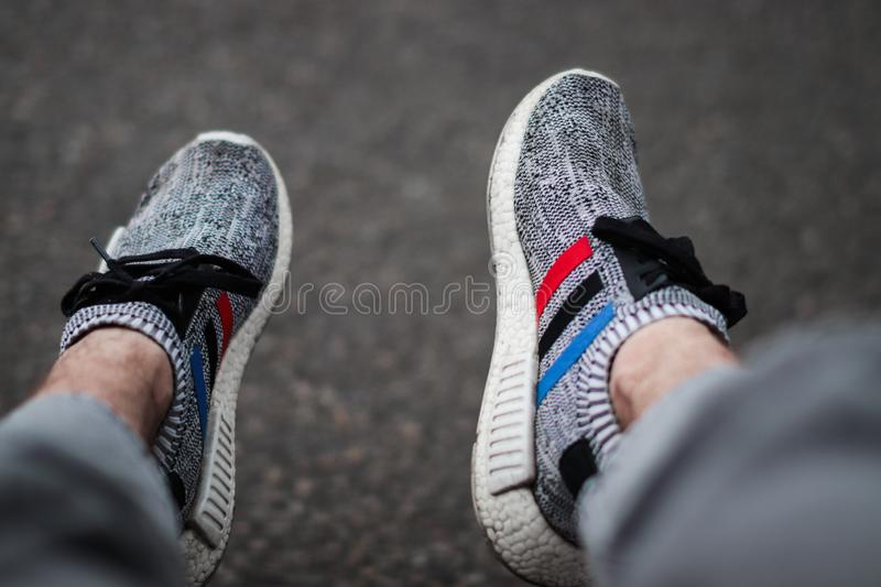 The brand adidas is constanly bringing out new shoe collections. One of there fashionable shoe is the adidas nmd. stock photography