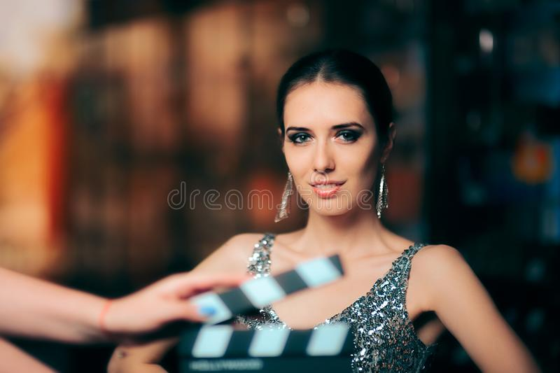 Glamorous Model Starring in Fashion Campaign Video Commercial. Brand ambassador diva endorsing a fashionable brand while shooting in a studio stock image