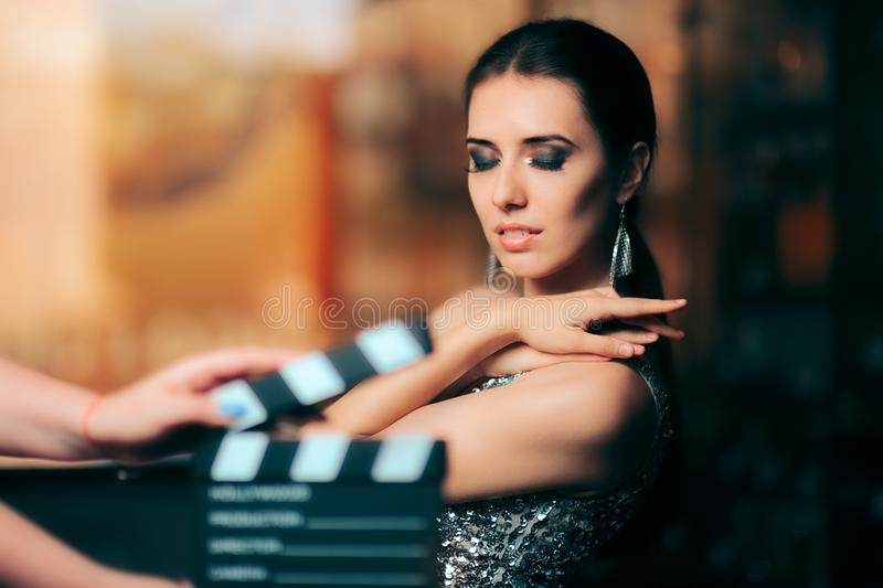 Glamorous Model Starring in Fashion Campaign Video Commercial. Brand ambassador diva endorsing a fashionable brand while shooting in a studio stock images