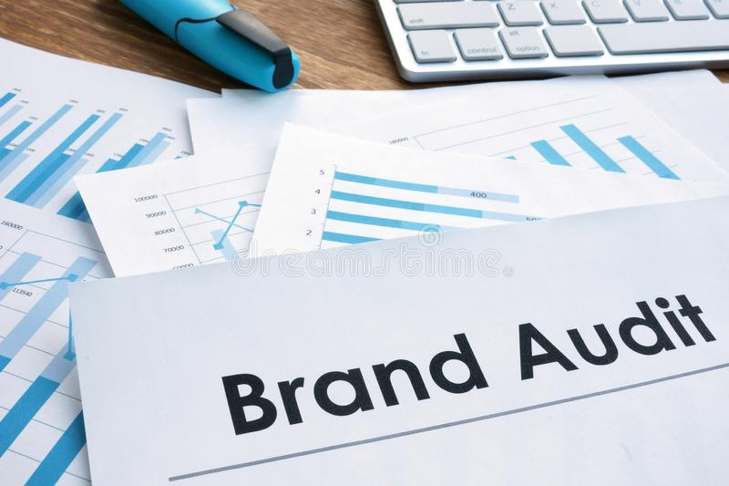 Brand audit report, documents and computer keyboard stock photos
