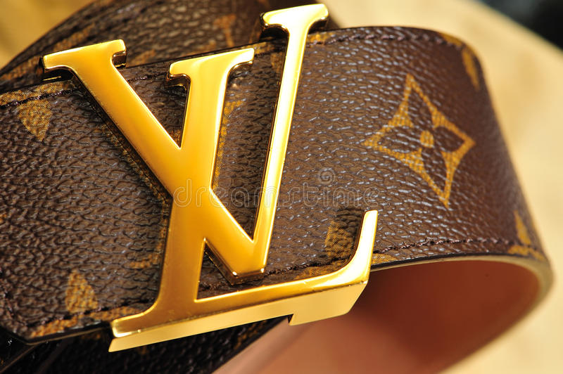 Brand belts. The image depicts a belt louis vuitton brand, the lights have been carefully arranged to illuminate the characteristic reflections of golden metal