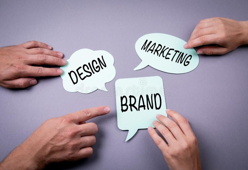 Brand, Design and Marketing Business concept. Speech bubble on a gray background royalty free stock photo