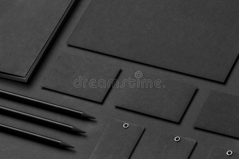 Brand identity mockup. Blank corporate stationery set at black t. Extured paper background royalty free stock image