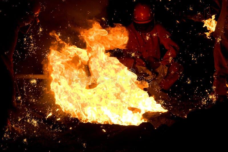 Brand med mannen i bakgrund royaltyfria bilder