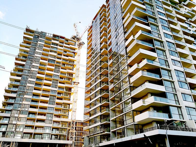 Brand new apartment buildings. New residential apartment buildings are almost completed royalty free stock image