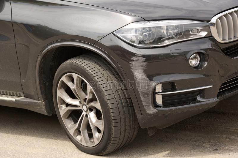 Brand new black SUV car get scratched car bumper damaged in collision royalty free stock photos