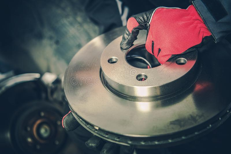 Brand New Brake Disc. Modern Car Brakes Replacement in Auto Service stock image