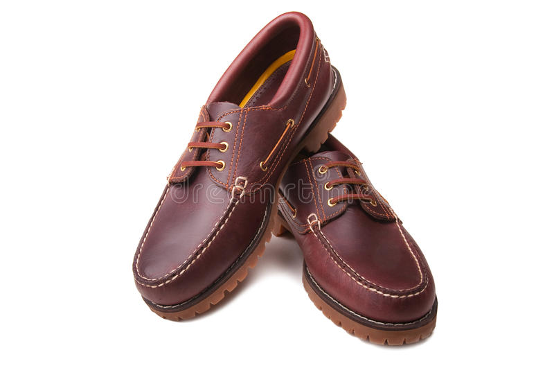 Brand new deck shoes. A brand new pair of men's leather deck shoes stock photo