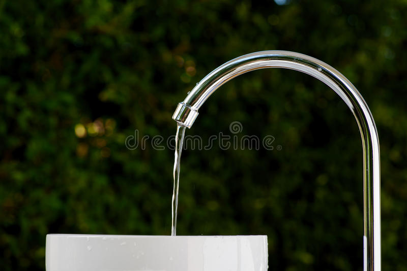 Brand new faucet. Brand new stainless steel faucet royalty free stock image