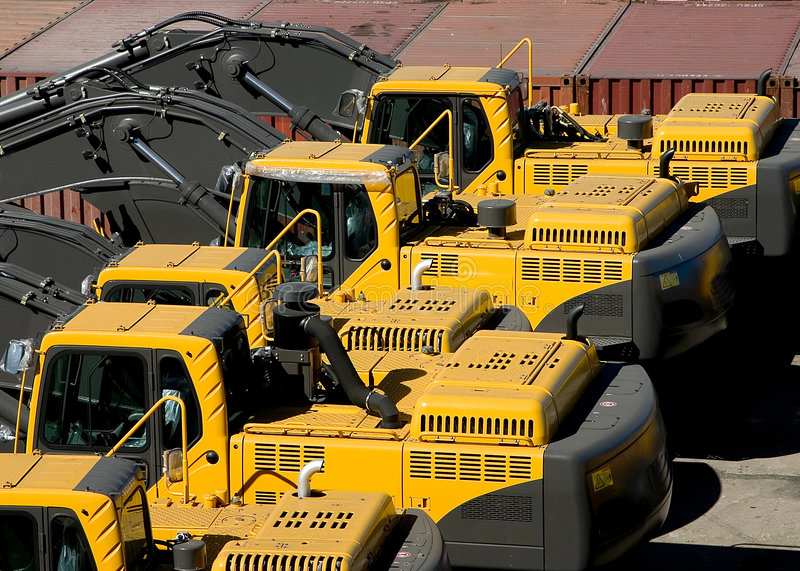 Brand new heavy equipment waiting on the docks royalty free stock photography