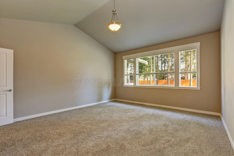 Brand new house construction interior. Empty room with vaulted ceiling. royalty free stock image