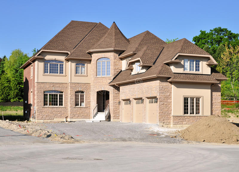 Brand new house with a triple garage royalty free stock photos