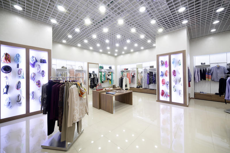 Brand new interior of cloth store royalty free stock photo