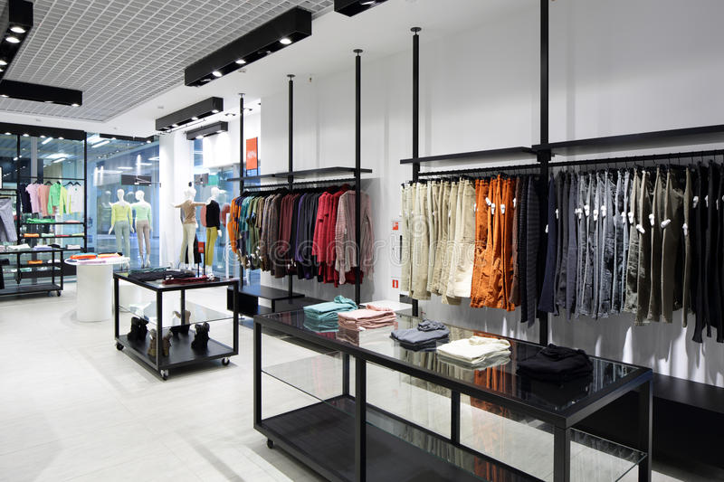 Brand new interior of cloth store. Luxury and fashionable brand new interior of cloth store royalty free stock images