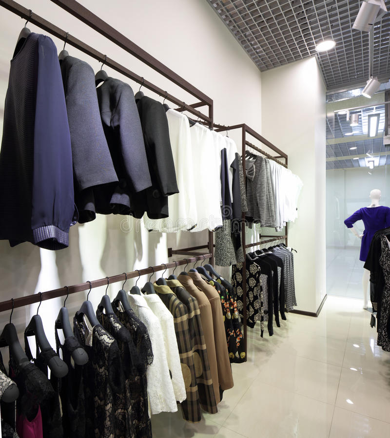 Brand new interior of cloth store. Luxury and fashionable brand new interior of cloth store stock photography