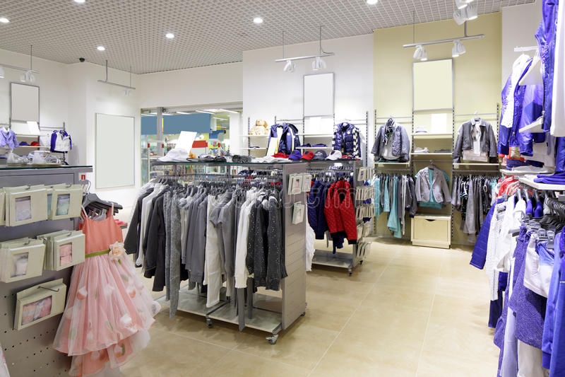 Brand new interior of kids cloth store stock image