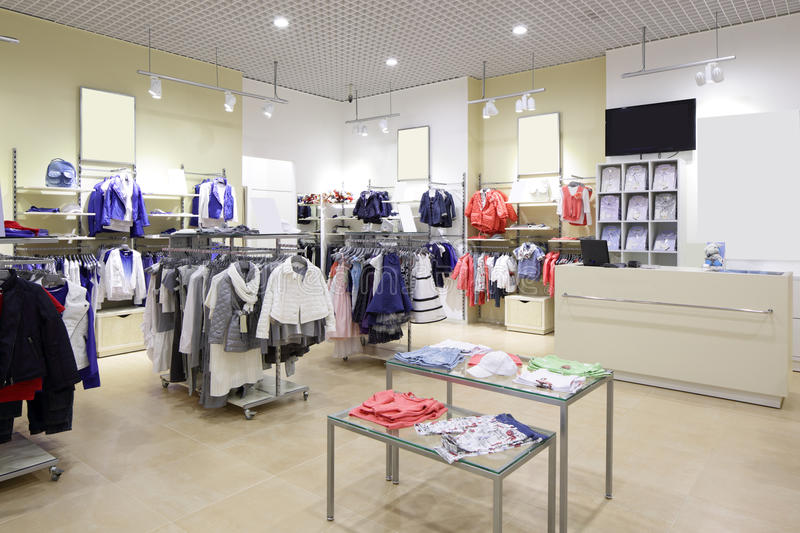 Brand new interior of kids cloth store royalty free stock images