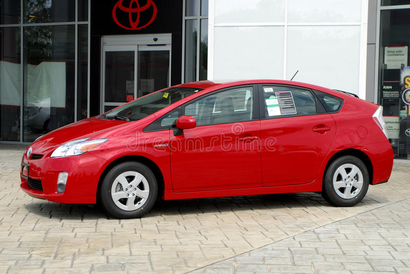 Brand New Toyota Prius. A brand new Toyota Prius sits at a dealers showroom stock photography