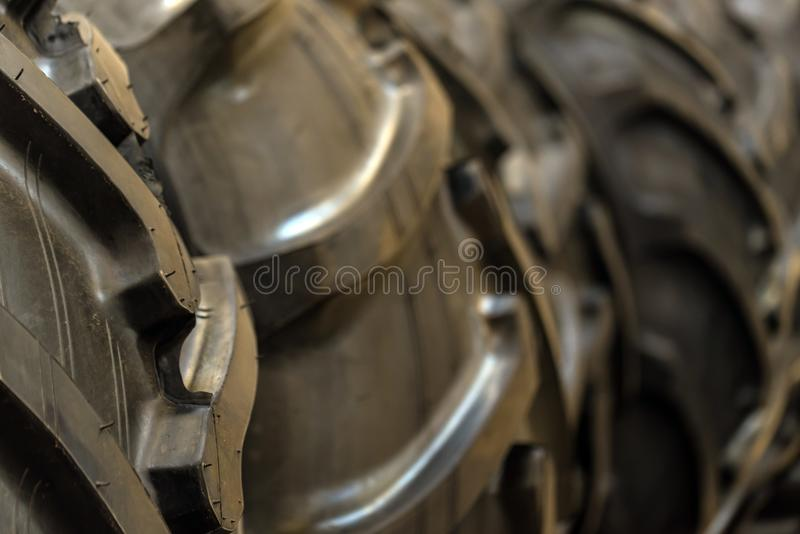Brand new tractor tires placed on factory floor stock images