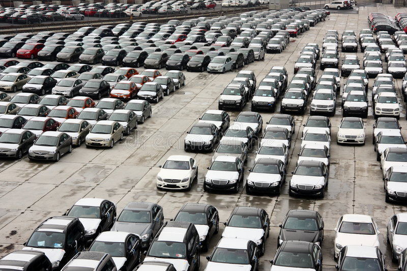 Brand-new vehicles at port. B rand new Honda Civics and luxury Mercedeses at warehouse in a port stock image