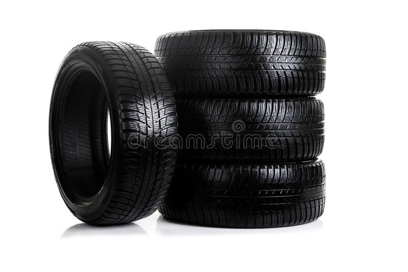 Brand new winter car tires with a modern tread isolated on white background royalty free stock photo