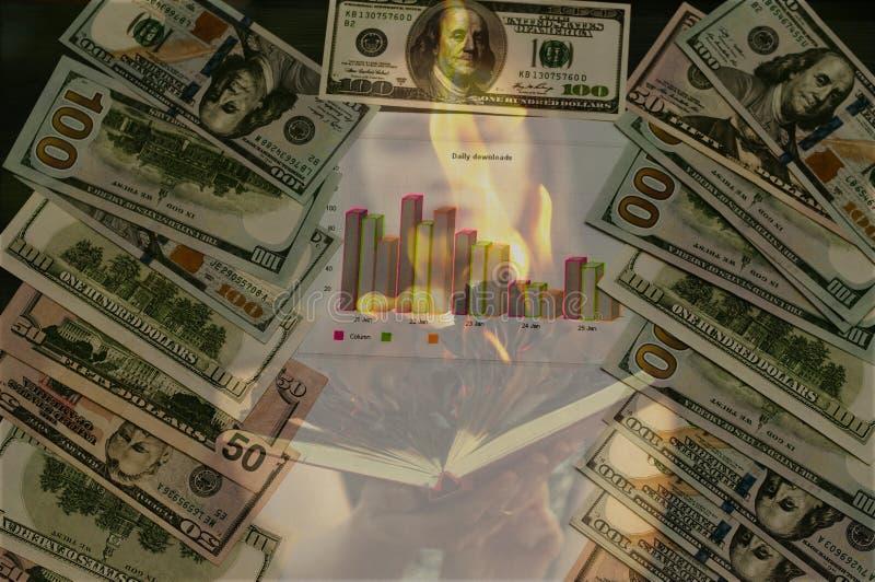 Brand och dollar, brinnande affischtavlor av pengar arkivfoto