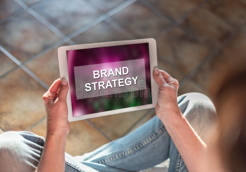 Brand strategy concept on a tablet stock photography
