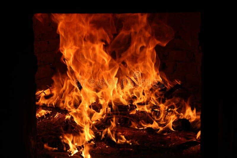 Brand, vlammen in de oven stock foto's