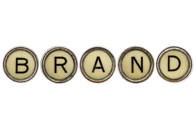 Brand word in typewriter keys stock photography