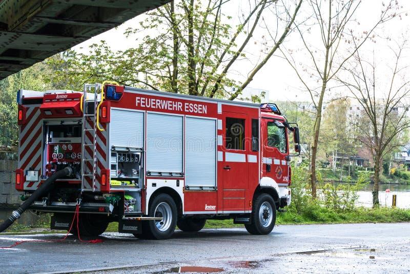 Brandbestrijders in Eenvormig tijdens opleiding royalty-vrije stock afbeelding