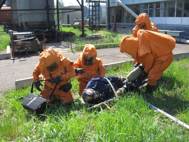 Brandbestrijders op doctrines stock foto