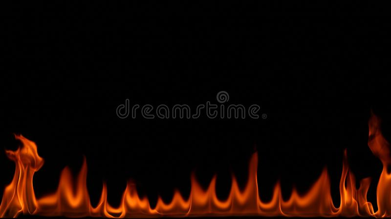 Brandeld på svart bakgrund arkivfoto
