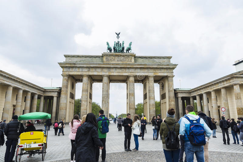 Brandenburg gate, Berlin, Germany. Berlin, Germany - April 12, 2017: Brandenburg gate full of tourists in Berlin, Germany on April 12, 2017 royalty free stock images