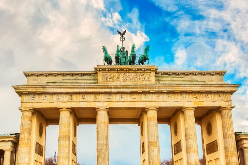 Brandenburg Gate Brandenburger Tor details in Berlin, Germany during bright day with a blue sky. Famous landmark in Berlin stock photo