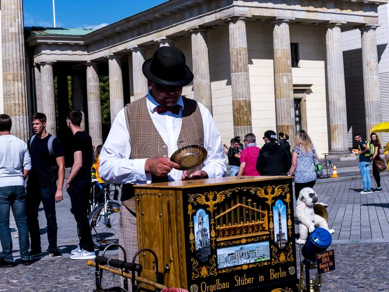 A traditional Organ Grinder by the Brandenburg Gate is Berlin`s most famous landmark. royalty free stock photo