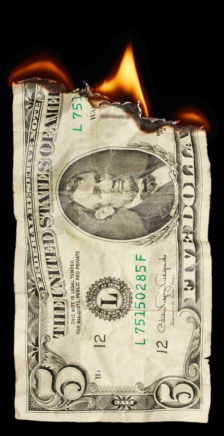 Brandende dollar stock foto
