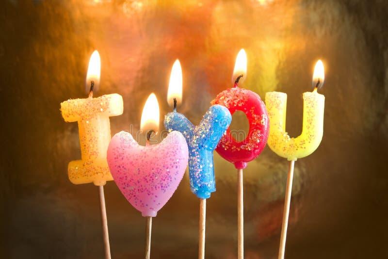 Brandende kaarsen die de liefde van I maken u stock foto