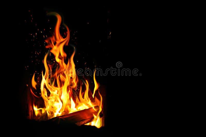 Brandende logboek en brand stock foto