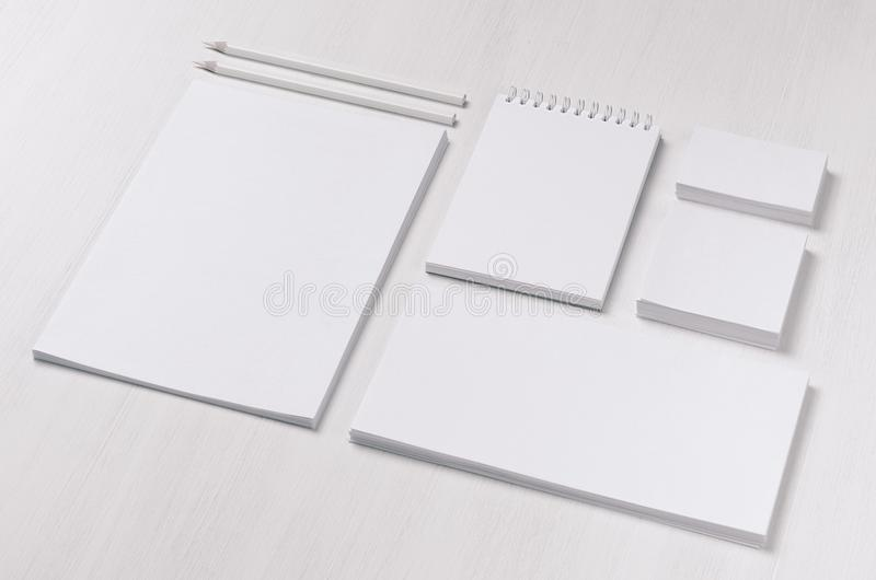 Branding business mock up of white blank stationery set on light soft white wooden background, inclined. royalty free stock photography