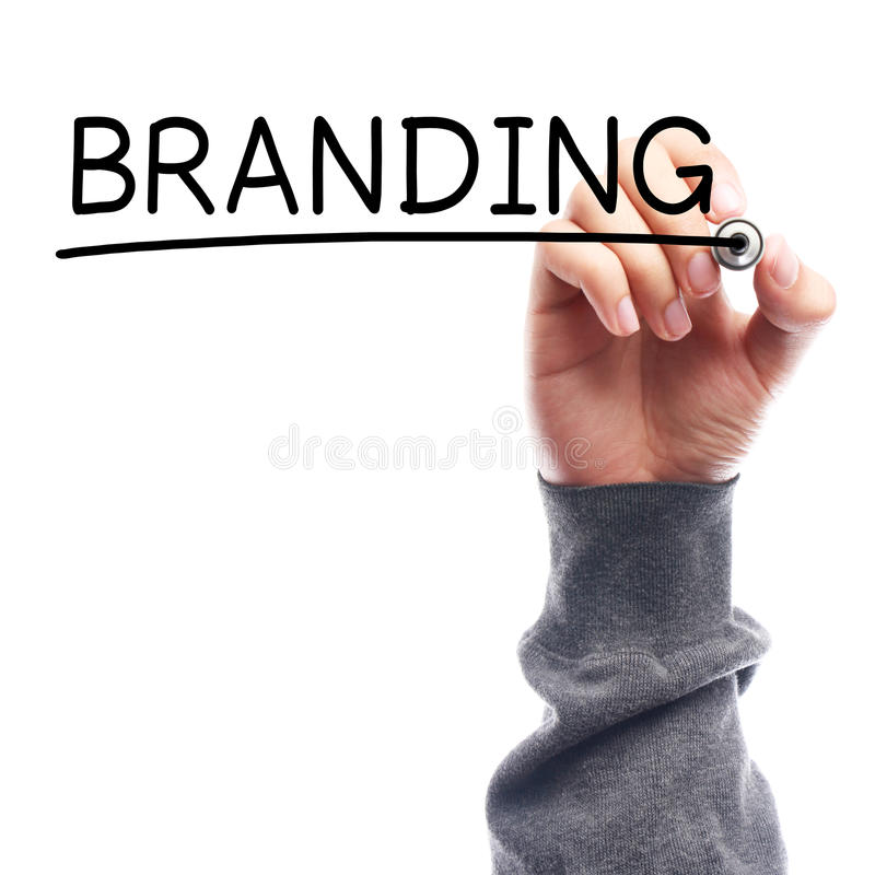 Branding. Hand with marker writing Branding on transparent board against white background stock image