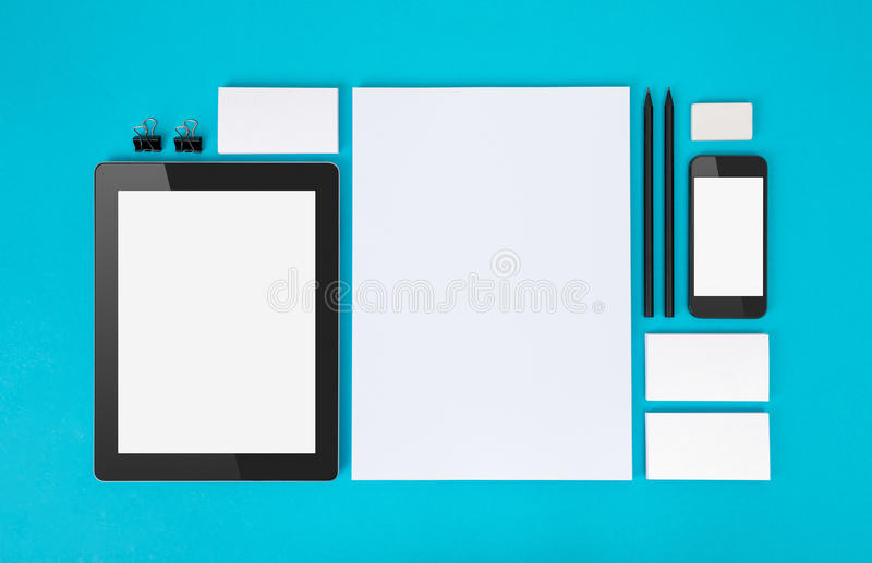 Branding identity objects. Set of variety blank office objects organized for company presentation or branding identity with blank modern devices. Isolated on