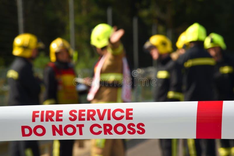 Brandmän på en viktig händelse royaltyfri bild