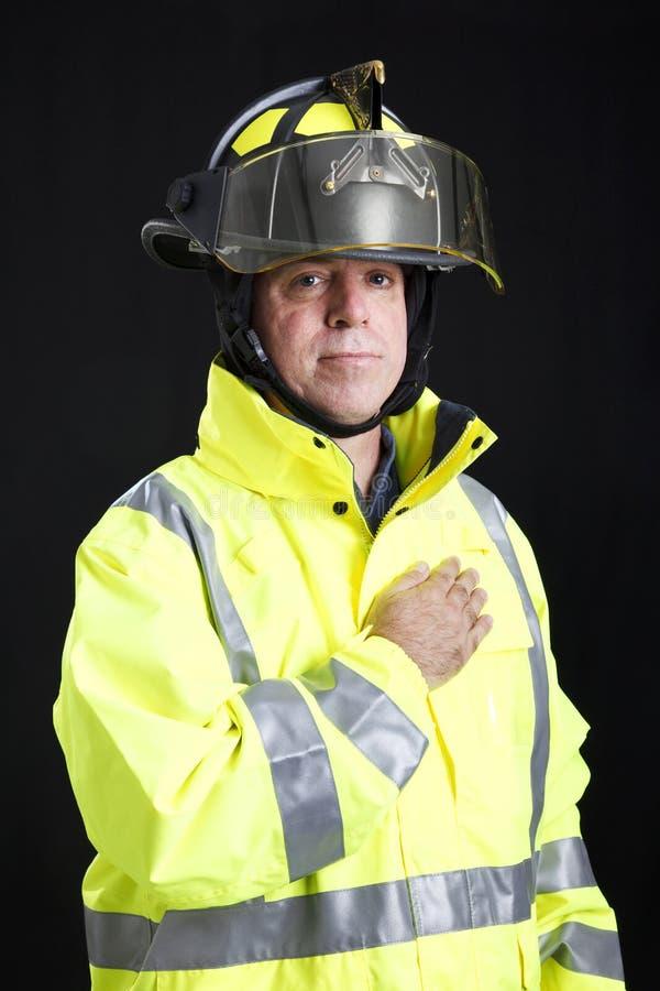 brandmanhandhjärta royaltyfria bilder