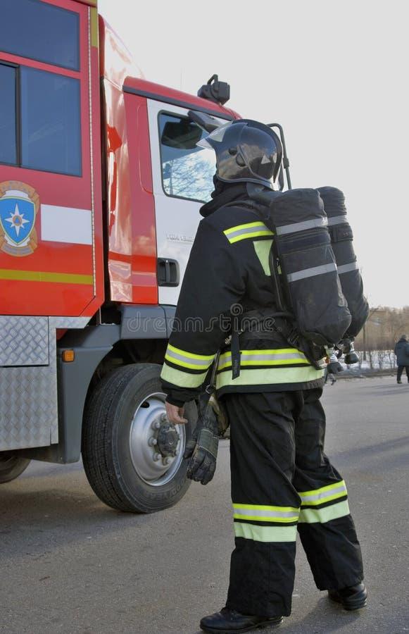 Brandmanstående Fototagande i Moskva royaltyfri foto