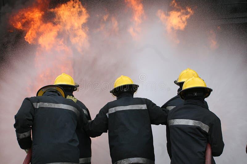 Brandvechter bij brand royalty-vrije stock afbeeldingen