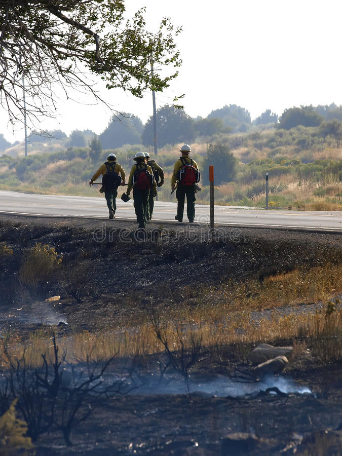 Brandvechters het lopen stock afbeeldingen