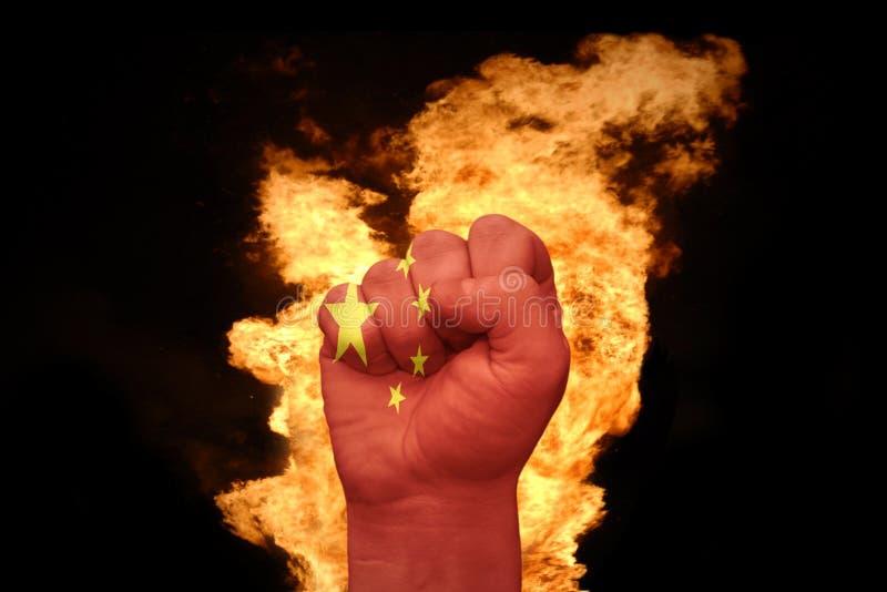 Brandvuist met de nationale vlag van China royalty-vrije stock foto