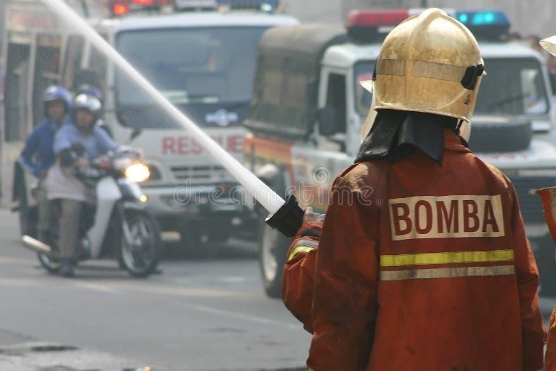 Brandweerlieden stock afbeeldingen
