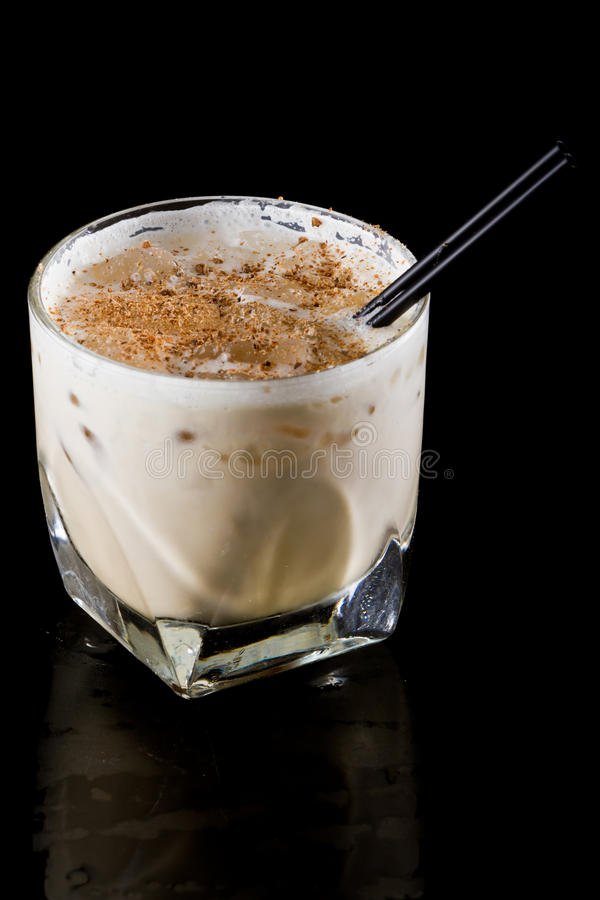 Brandy alexander. Classic cocktail brandy alexander served on the rocks isolated on black stock image
